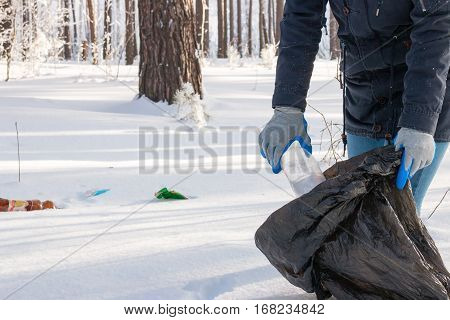 Girl Collects Garbage In The Winter Forest