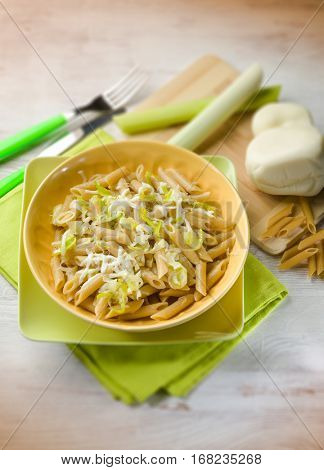 pasta with leek and scamorza cheese, selective focus
