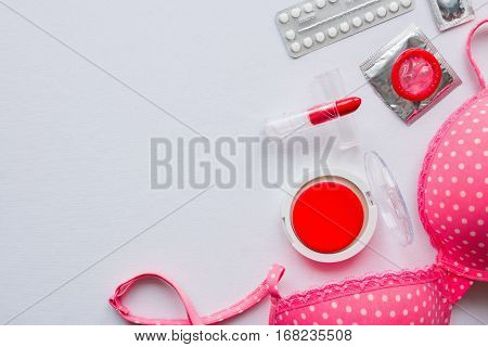Female Accessories And Contraceptives On A White Background With Space For Text