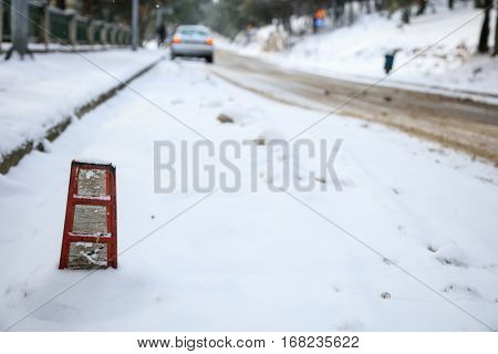 Car on a covered with snow road