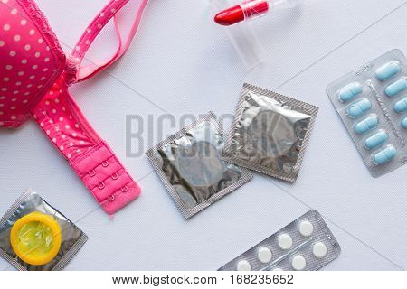 Bra And Contraceptives On A White Background