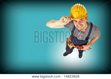 young caucasian handyman on abstract blue background