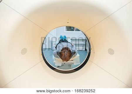 Close Up Patient At Ct Scan Tomography In Hospital, Shot Through The Tube Of Device. Selective Focus