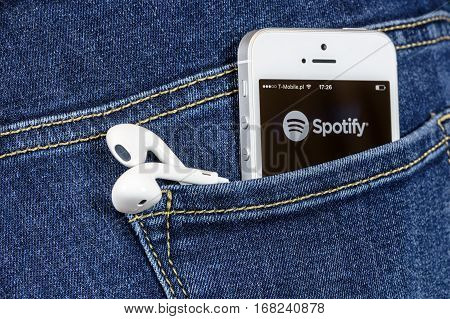 Krynica Poland - February 02 2017: Spotify app on iPhone SE screen in blue jeans pocket. Spotify is one of the most popular music service app on the world.