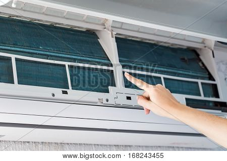 Finger Show On Dirty Filter Of Air Conditioner