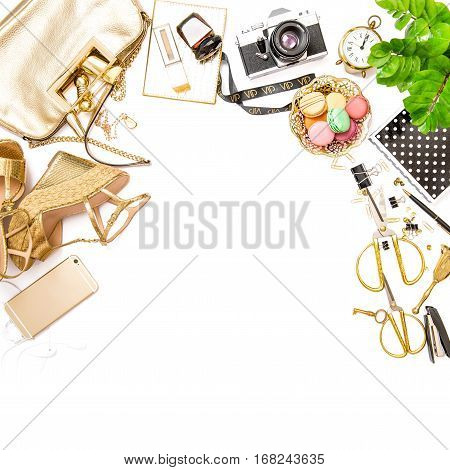 Fashion flat lay for web site social media. Feminine accessories bag shoes office supplies phone green plant on white table background. Square image