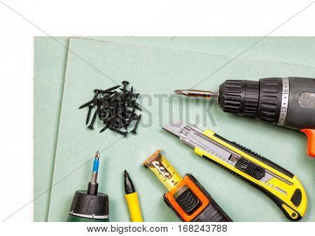Plasterboard tools set with screws, tape measure, screwguns cutter and marker pen