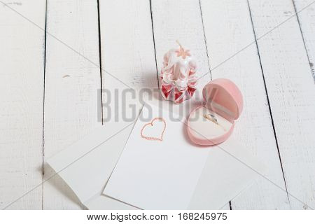 St. Valentine's Day: the offer on a romantic appointment. Two carved candles, pink box and note. Love.