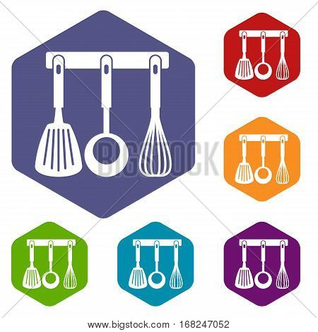 Spatula, ladle and whisk, kitchen tools on a hanger icons set rhombus in different colors isolated on white background