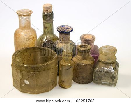 Old styled dirty glass bottles from laboratory