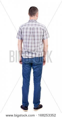 Back view of handsome man in shirt. Standing young guy in jeans. Rear view people collection.  backside view of person.  Isolated over white background.