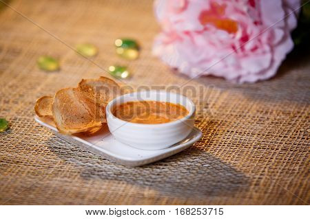 Sauce With Croutons In A White Cup