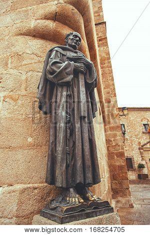 CACERES SPAIN - September 29 2013: Statue of San Pedro de Alcantara near the Cathedral of St. Mary Extremadura Spain