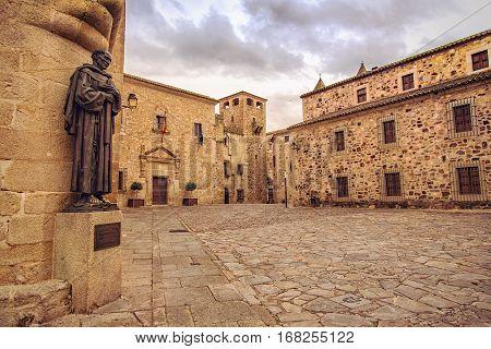 CACERES SPAIN - September 29 2013: Plaza de Santa Maria and statue of San Pedro de Alcantara near the Cathedral of St. Mary Extremadura Spain