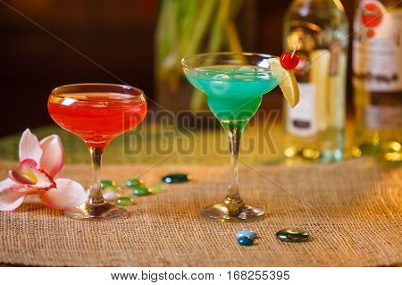 drinks in tall glasses - martini and dessert
