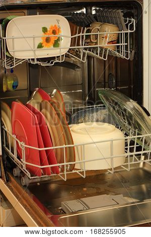 United dishwasher full of dirty dishes to wash