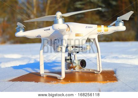PILSEN CZECH REPUBLIC - JANUARY 19, 2017: Drone quadrocopter Dji Phantom 3 Professional with camera. Farmer use drone for inspect of damages from wild boars on wheat fields in winter season.
