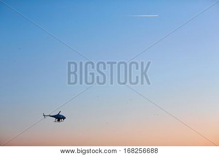 Coast guard helicopter flying against blue sky