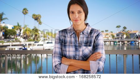 Millennial White Girl Poses For A Portrait By The Marina