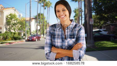 Young White Girl Standing In A California Suburban Neighborhood