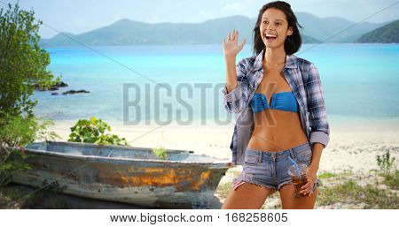 Young White Girl Poses On The Caribbean Beach With A  Drink