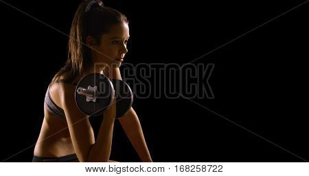 Young Caucasian Woman Works Out On A Black Background With Copy Space