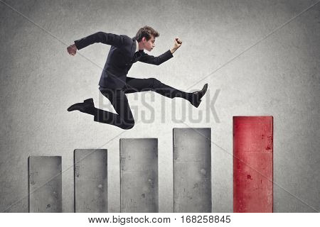 Businessman in suit running all the way up to the top