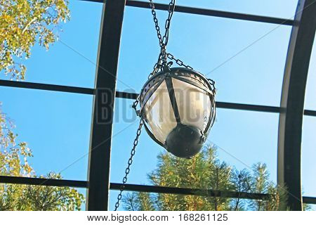 Wrought iron arbor with lantern with blue sky