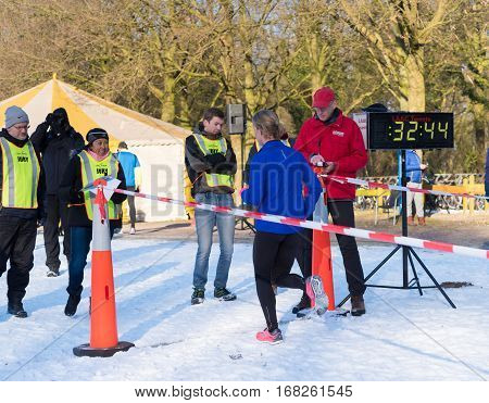 OLDENZAAL NETHERLANDS - JANUARY 22 2017: unknown people at the finishing line during a running race in the snow