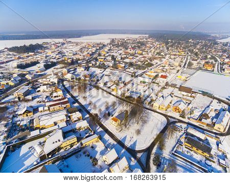 Aerial view to snowy village in Western Bohemia. Winter on Countryside, Czech Republic, Europe.