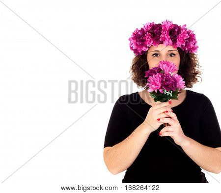Happy girl with a branch and crown with pink and purple flowers isolated on a white background