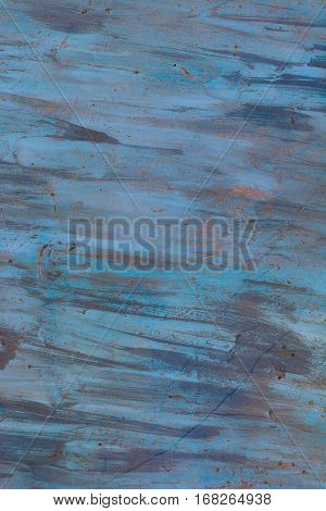 The texture of the painted iron. Blue stains rust. Vertical background.