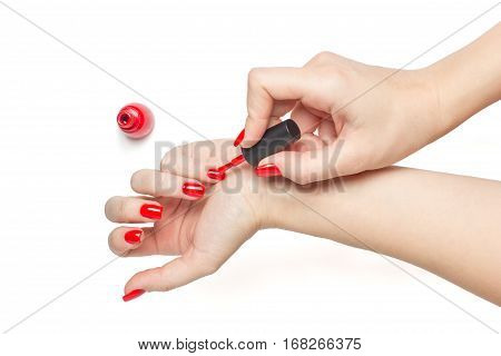 Manicure - Beautiful manicured woman's nails with red nail polish on white background