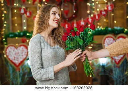 Valentines Day concept. woman celebrating. Lover present each other bouquet of red roses