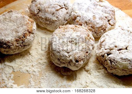 Rissoles, Made From Minced Meat, Onion And Breadcrumbs, Rolled In Flour And Ready To Be Fried