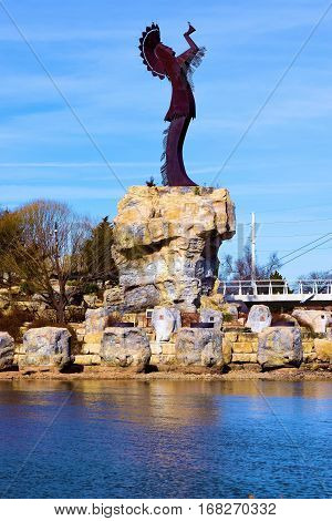 January 29, 2017 in Wichita, KS:  Keeper of the Plains Sculpture at an island on the Arkansas River and where people can walk up to the sculpture and reflect on Native American history taken in Downtown Wichita, KS