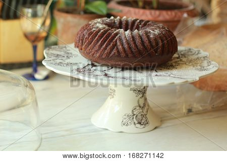 This is a pumpkin ginger bundt cake in a kitchen on a cake platter