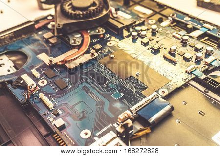 Disassembled laptop. Technology and hardware electronic concept. Motherboard digital chip. Tech science background. Integrated communication processor. Information engineering component