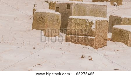 Large stone blocks in a wilderness area covered with snow