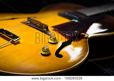 Jazz Arch top guitar on a black background