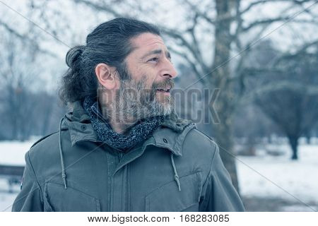 Handsome unshaven middle aged man on winter day