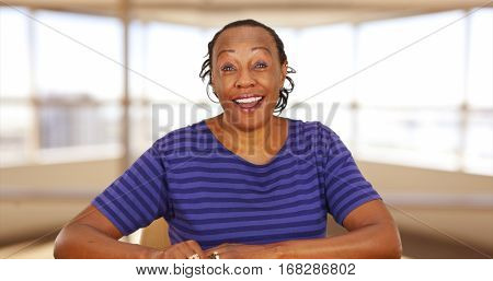 A Casually Dressed Black Businesswoman Smiling At Camera