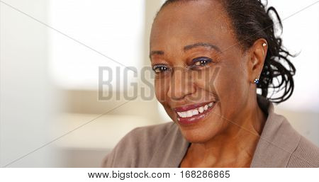Close-up Of A Smiling Elderly African American Woman At Work