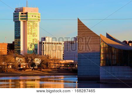 January 29, 2017 in Wichita, KS:  Pedestrian pathway alongside highrise buildings next to the Arkansas River creating the city skyline where people can walk alongside the river in Downtown Wichita, KS