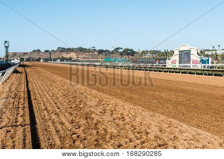 DEL MAR, CALIFORNIA - NOVEMBER 25, 2016:  Tote board and dirt track of the second largest horse racing venue in the western United States.
