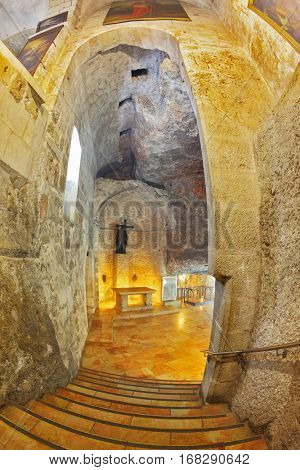 JERUSALEM, ISRAEL - MARCH 9, 2012: The entrance hall in the Holy Sepulchre. Opening in the wall carved into the rock and decorated with ten steps leading down