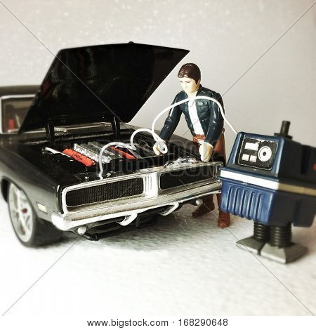 Vintage Kenner Star Wars Empire Strikes Back Han Solo with a Power Gonk GNK Droid jumpstarting a 1969 Dodge Charger