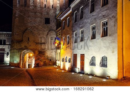 Night View Of Historic Town Sighisoara, Romania. City In Which Was Born Vlad Tepes, Dracula