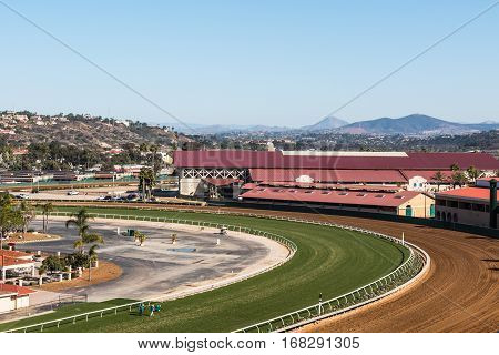 DEL MAR, CALIFORNIA - NOVEMBER 25, 2016:  Thoroughbred horse racing track and surrounding area with mountains in the distance.