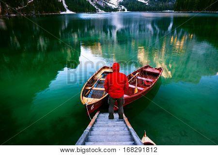 Man Alone At The Braies Lake ( Pragser Wildsee ) In Dolomites Mountains